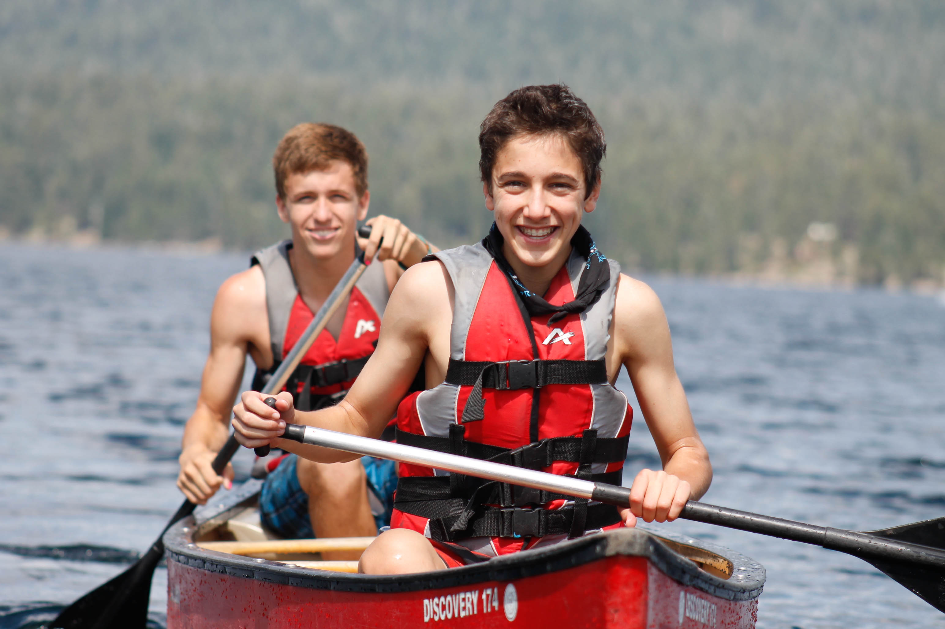 Two kids on canoe