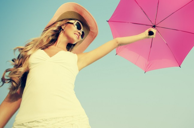 woman in sunglasses with umbrella