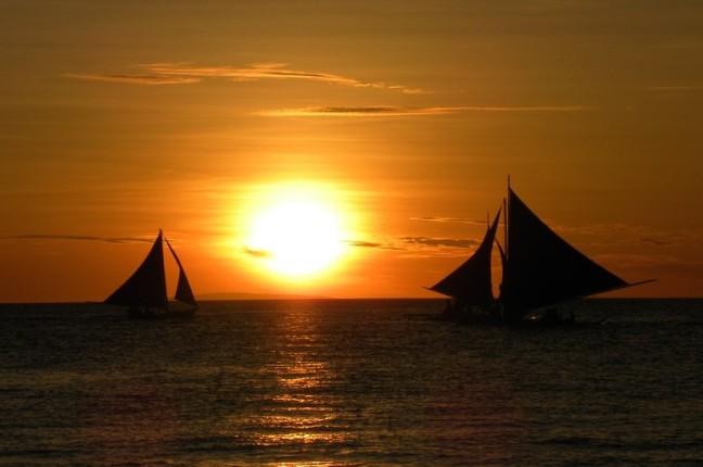 boats sailing during sun set