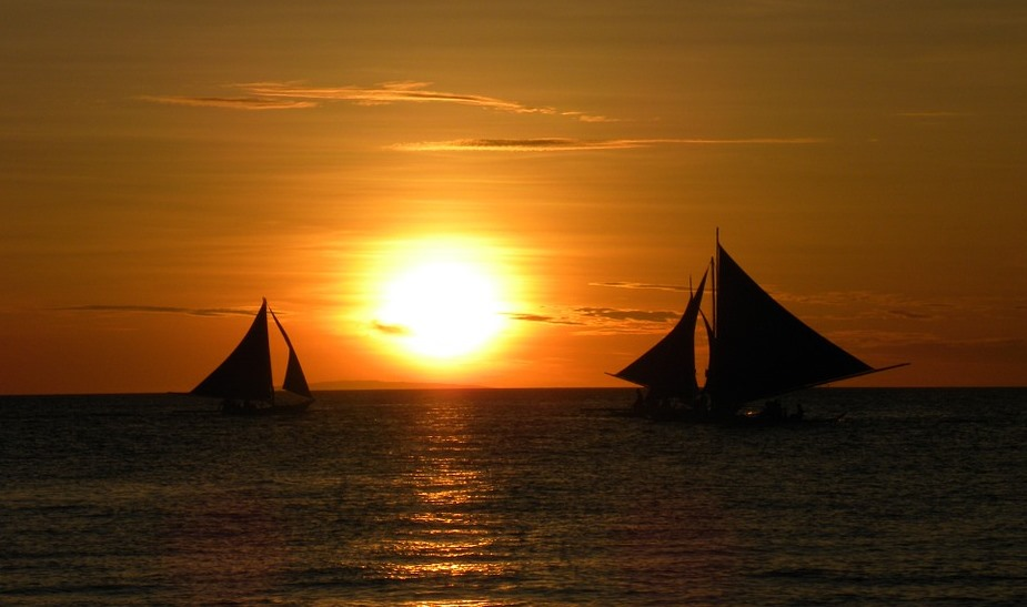 boats sailing during sun set